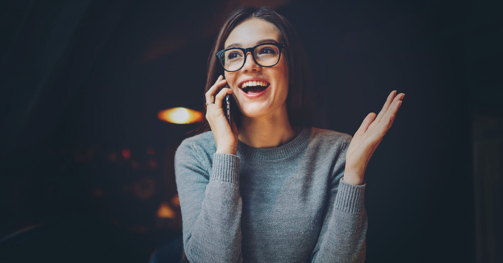 Smiling woman holding phone